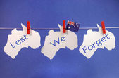 Remembrance, November 11, or Anzac Day, April 25, public holiday with a bright and vivid pegs on a line message greeting — Stock Photo
