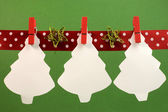 Christmas treas hanging from pegs on a line with copy space for your text here. — Stock Photo
