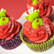Christmas cupcakes with fun and quirky reindeer faces — Stock Photo #28086405