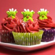 Christmas cupcakes with fun and quirky reindeer faces — Stock Photo #28086429