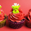 Christmas cupcakes with fun and quirky reindeer faces — Stock Photo #28086445
