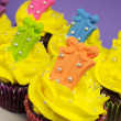Bright festive cupcakes with gift decorations for Christmas, Easter, birthday or Children's party — Стоковая фотография