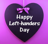 Happy Left-handers Day message sign text written on heart shape blackboard — Stock Photo