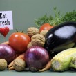 Stock Photo: Healthy diet of fresh raw vegetables and nuts