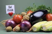 Healthy diet of fresh raw vegetables and nuts — Stock Photo