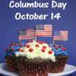 Happy Columbus Day for October 14 message and Red, White and Blue chocolate cupcakes with USA Stars & Stripes flags — Stock Photo