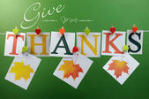 Give Thanks message across pegs on a line for Happy Thanksgiving greeting with hanging leaves — Stock Photo