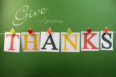 Give Thanks message across pegs on a line for Happy Thanksgiving greeting — Stock Photo