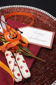 Happy Halloween black table place setting with red polka dot cutlery. — Stock Photo