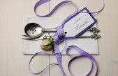 Purple shabby chic wedding table place setting with Just Married tag — Stock Photo