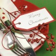 Traditional red and green Christmas lunch or dinner table place setting. — Stock Photo