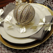 Gold metallic theme Christmas formal dinner table place setting — Stock Photo