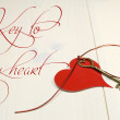 Key to my Heart romantic love gesture concept with red heart on shabby chic table — 图库照片