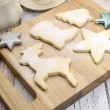 Christmas shapes shortbread cookies with cup of tea  — Stock Photo