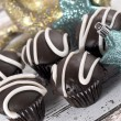 Chocolate stripe cupcakes with reindeer and stars Christmas ornaments — Stock Photo