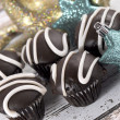 Chocolate stripe cupcakes with reindeer and stars Christmas ornaments — Stock Photo #35733295