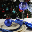Beautiful Christmas table place setting with lone stem crystal wine glasses — Stock Photo #35868873