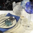 Beautiful Christmas table place setting with lone stem crystal wine glasses — Stok fotoğraf