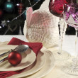 Beautiful Christmas table place setting with lone stem crystal wine glasses — Stock Photo