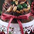 Stock Photo: Festive holiday food, Christmas Fruit Cake, on white ornate cake stand.