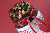 Festive holiday food, Christmas Fruit Cake, on white ornate cake stand. — Stock Photo