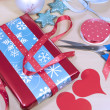 Gift wrapping red, white and blue Christmas present gifts. — Стоковая фотография