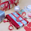 Gift wrapping red, white and blue Christmas present gifts. — Stock Photo