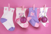 Merry Christmas children baby stockings on pink background — Stock Photo
