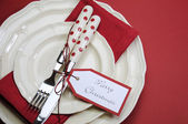 Red dining table place setting with Merry Christmas tag — Stock Photo