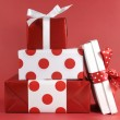 Stack of red and white polka dot theme festive gifts — Stock Photo #37239899