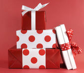 Stack of red and white polka dot theme festive gifts — Stock Photo