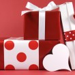 Stack of red and white polka dot theme festive gifts — Stock Photo #37240163