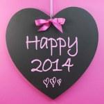 Happy New Year 2014 message greeting written on heart shape blackboard — ストック写真