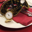 New Years Eve dining table place setting with masquerade mask — Stock Photo #37279723