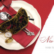 New Years Eve dining table place setting with masquerade mask — ストック写真