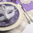 Stock Photo: New Years Eve dining table place setting with masquerade mask