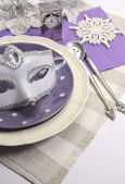 New Years Eve dining table place setting with masquerade mask — Stock Photo
