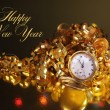Gold pocket fob watch ready for midnight on New Years Eve — Stock Photo