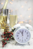 Happy New Year table with retro white clock and champagne — ストック写真