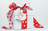 Red and white polka dot gift — Stock Photo