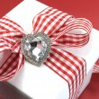 Red and white check gift for Valentine, Christmas, Mothers Day or birthday present. — Stock Photo