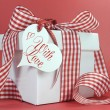 Red and white check gift for Valentine, Christmas, Mothers Day or birthday present. — Stock Photo #38445021