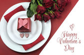 Happy Valentines Day dining table setting, with red hearts, gift, and red roses, with greeting. — Stockfoto