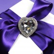 Stock Photo: Beautiful purple ribbon on white gift for special occasions.