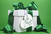 Beautiful green and white gift — Stock Photo