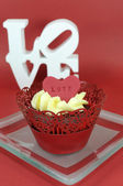 Red velvet cupcakes for Valentines Day or love theme holidays or birthdays — Stockfoto