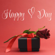 Happy Heart Day, with love heart symbol, greeting with red rose and black jewelry box — Stock Photo