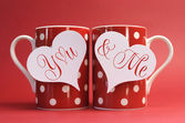 You and Me, love message greeting on heart gift tags on red polka dot coffee mugs — Stock Photo