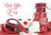 Red gift wrapping with greeting — Stock Photo