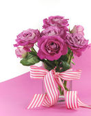 Beautiful pink gift roses on pink and white background — Stock Photo